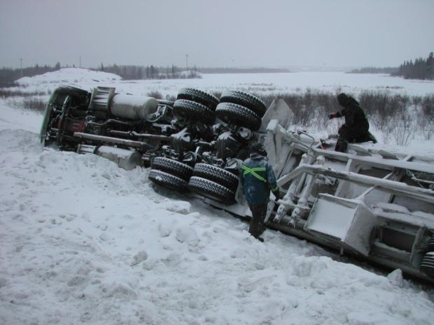 Overturned transport truck, ice road, NWT.