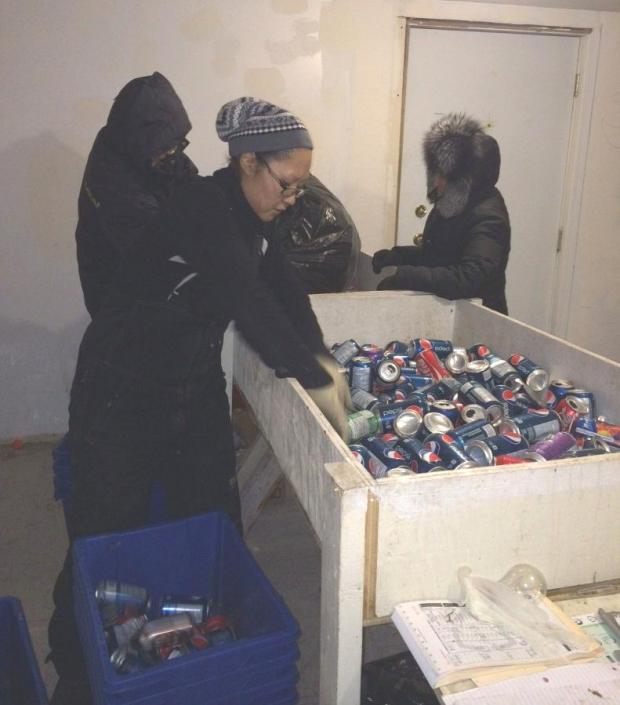 Counting aluminum cans before issuing a refund to a community resident.