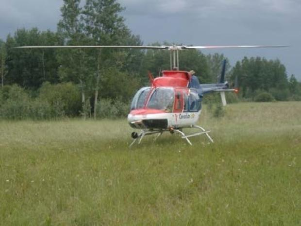 Helicopter landed on the Taiga Plains