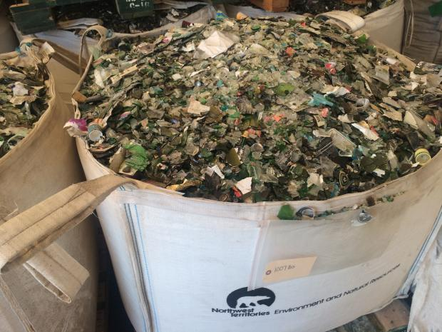 Bags of non-refillable glass prior to shipment to Airdrie, Alberta for processing into fibreglass insulation.