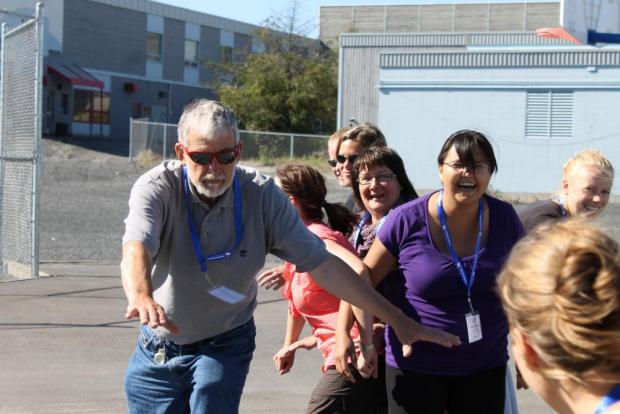 Teachers participating in Project Wet activity.